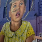 Little girl on wall